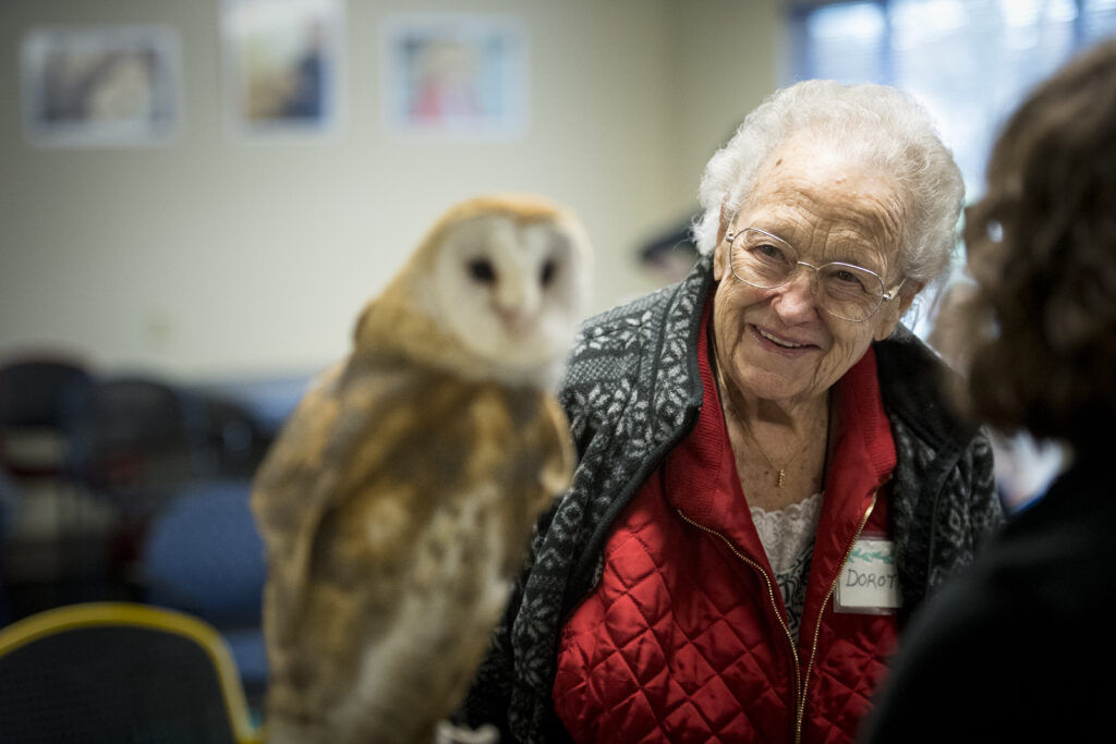 Dorothy meeting a live owl during a Grace Center activity