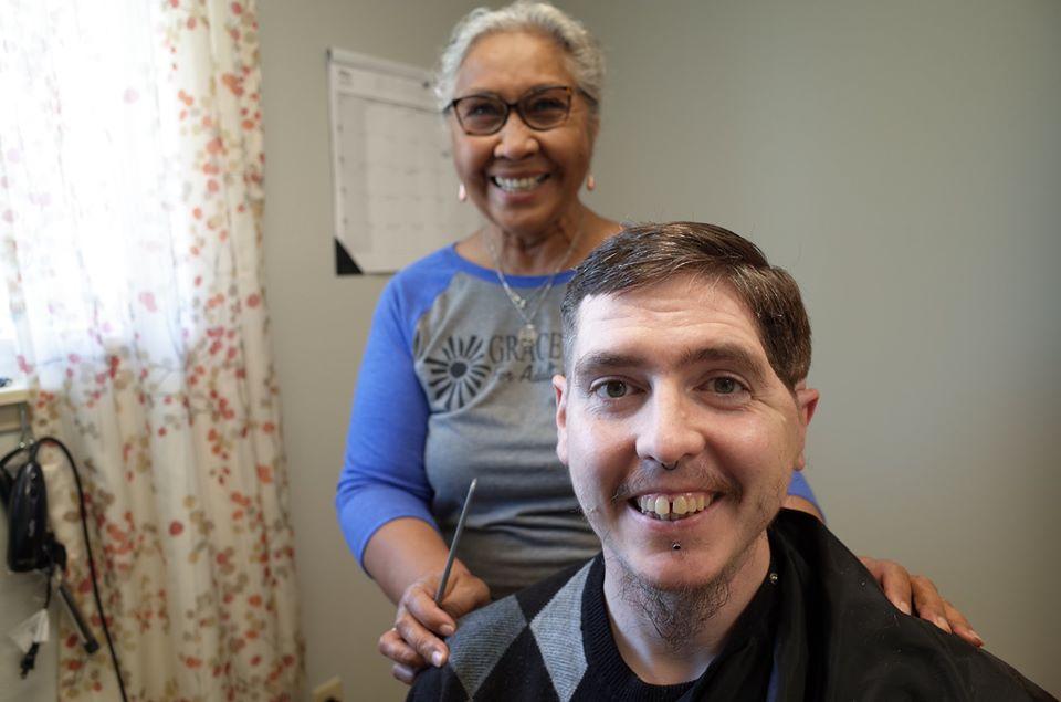 A Grace Center participant getting a hair cut in Grace Center's salon
