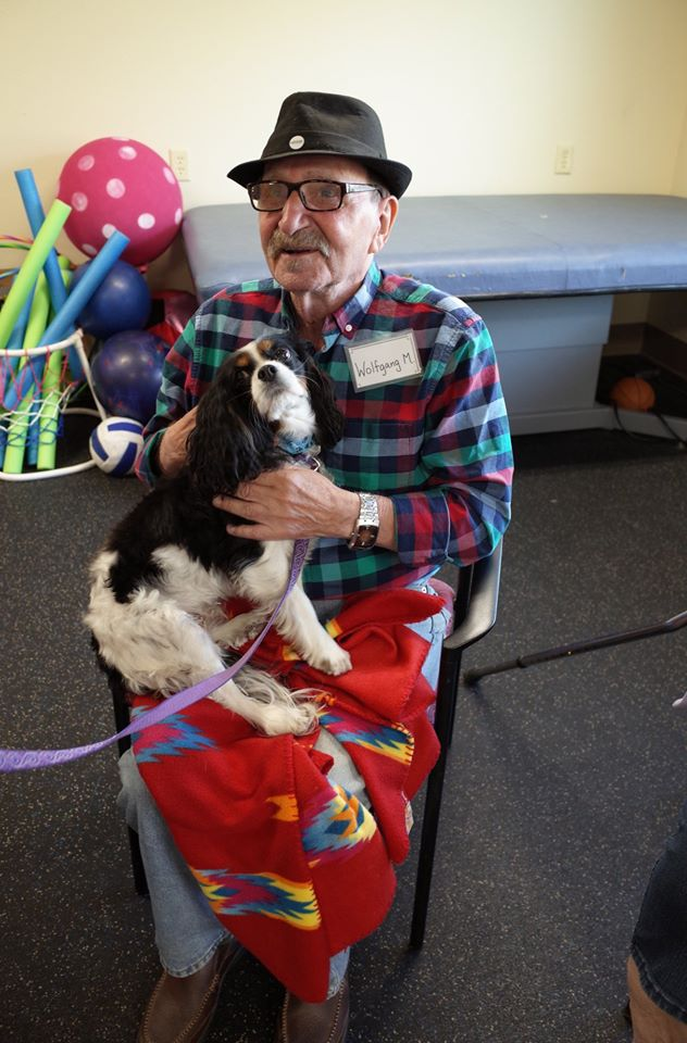 A Grace Center participant with a dog during an animal therapy activity