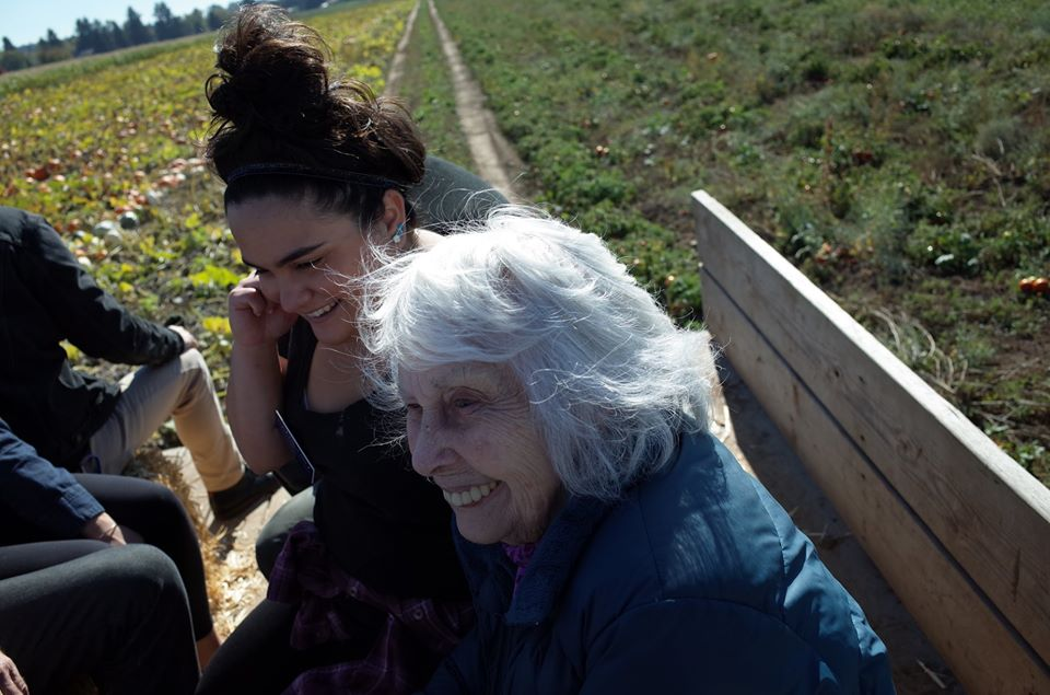 A Grace Center intern and participant on a hayride together at a Grace Center outing to a pumpkin patch