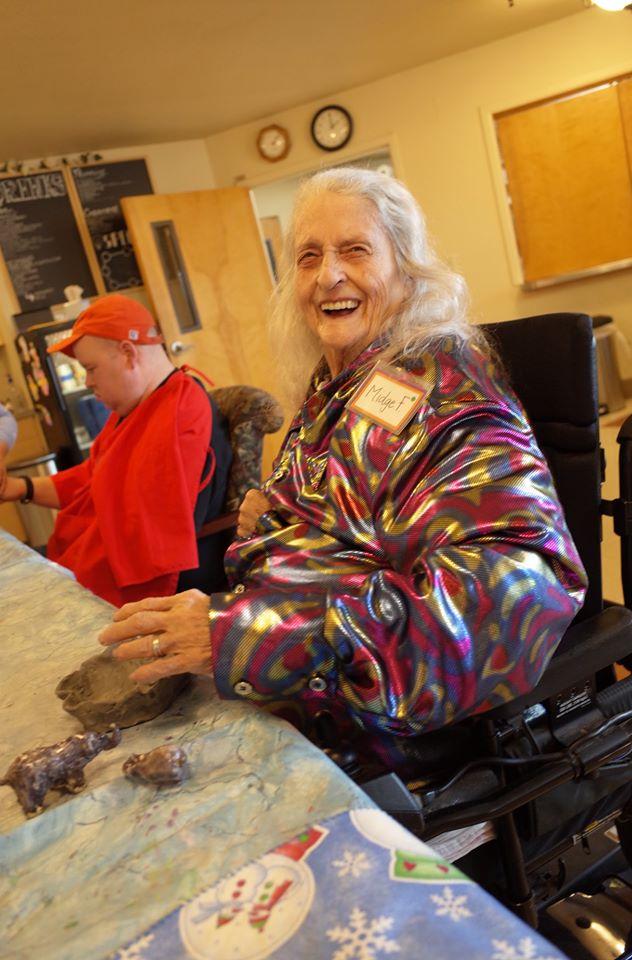 A Grace Center participant in a ceramics class