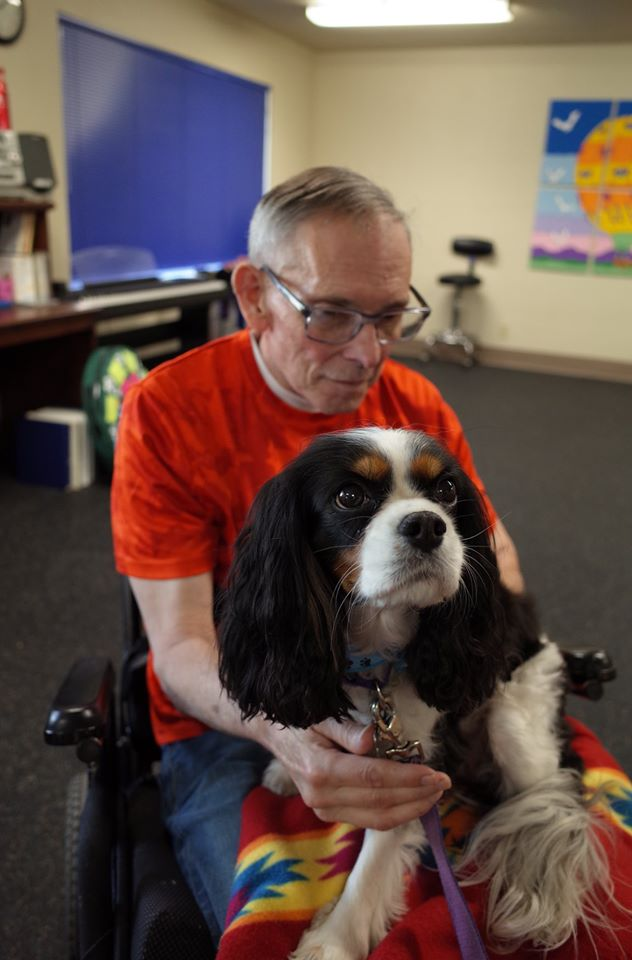 Andy with a dog during a Grace Center animal therapy activity