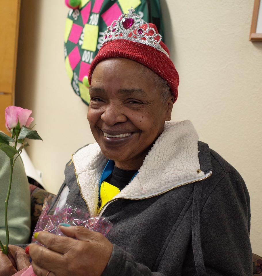 A Grace Center participant getting crowned queen at the annual Grace Center Valentine's Day party